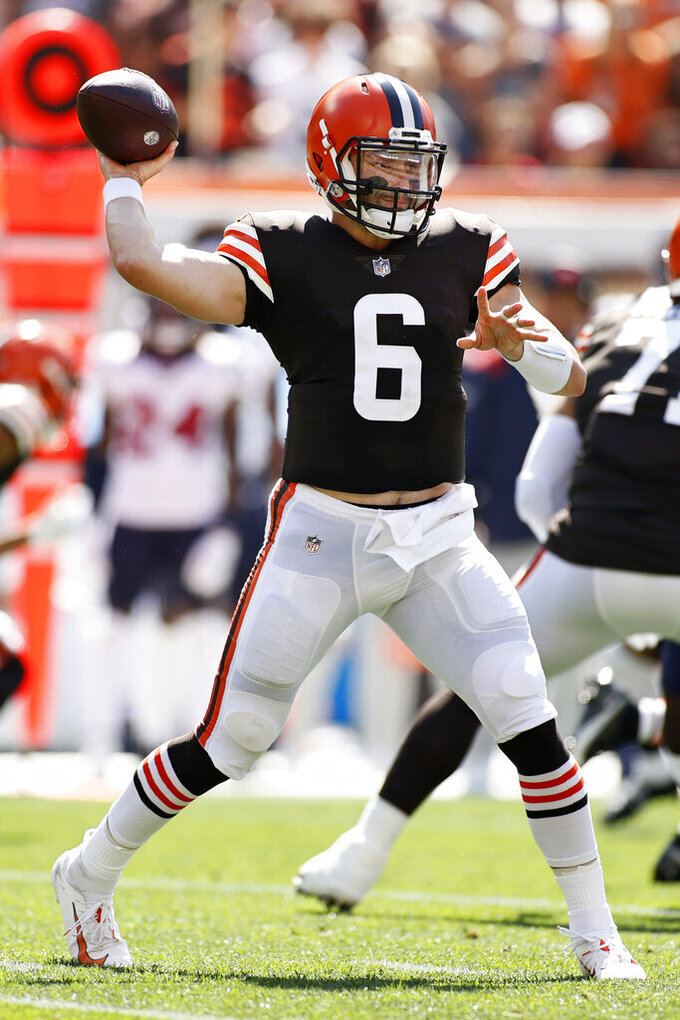 Cleveland Browns quarterback Baker Mayfield throws during the first half of an NFL football game against the Houston Texans, Sunday, Sept. 19, 2021, in Cleveland. (AP Photo/Ron Schwane)