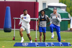 New York Giants running back Saquon Barkley, left, runs a drill at NFL football training camp, Wednesday, July 28, 2021, in East Rutherford, N.J. (AP Photo/Corey Sipkin)