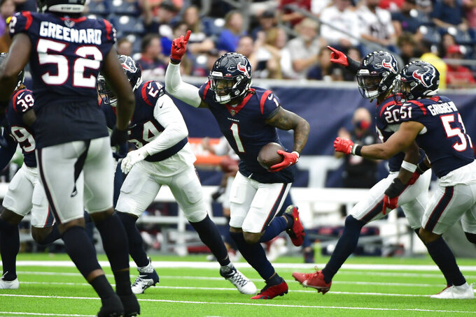 Houston Texans cornerback Lonnie Johnson Jr. (1) celebrates after intercepting a pass against the New England Patriots during the second half of an NFL football game Sunday, Oct. 10, 2021, in Houston. (AP Photo/Justin Rex)