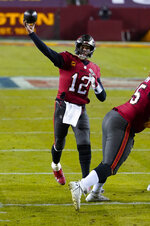 Tampa Bay Buccaneers quarterback Tom Brady (12) throws a pass during the first half of an NFL wild-card playoff football game against the Washington Football Team, Saturday, Jan. 9, 2021, in Landover, Md. (AP Photo/Al Drago)