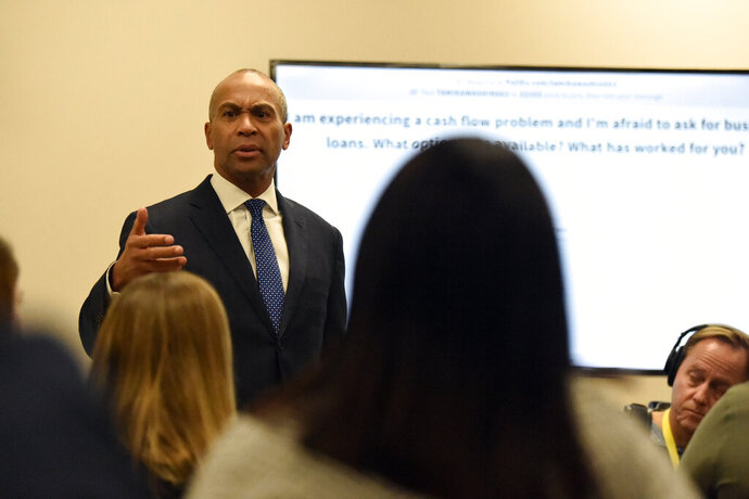 Democratic presidential hopeful and former Massachusetts Gov. Deval Patrick speaks with business owners during a campaign stop, Tuesday, Nov. 19, 2019, in Columbia, S.C. (AP Photo/Meg Kinnard)