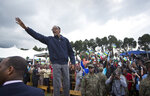 "FILE - In this Saturday, Sept. 5, 2015 file photo, Rwanda's President Paul Kagame waves to the crowd before speaking at a baby gorilla naming ceremony in Kinigi, northern Rwanda. The new book ""Do Not Disturb"" by British author Michela Wrong questions why some in the international community continue to praise Rwandan President Paul Kagame despite repression in his central African country. (AP Photo/Ben Curtis, File)"