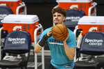 Charlotte Hornets guard LaMelo Ball, wearing a cast on his fractured right wrist, shoots before an NBA basketball game between the Charlotte Hornets and the Atlanta Hawks in Charlotte, N.C., Sunday, April 11, 2021. (AP Photo/Nell Redmond)