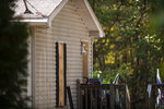 Windows are boarded up on Friday, Oct. 9, 2020, at a house in Munith, Mich., where law enforcement officials said suspects accused in a plot to kidnap Michigan Democratic Gov. Gretchen Whitmer met to train and make plans. Pete Musico and Joseph Morrison, who officials said lived at the house, have been charged in the plot. (Nicole Hester/Ann Arbor News via AP)