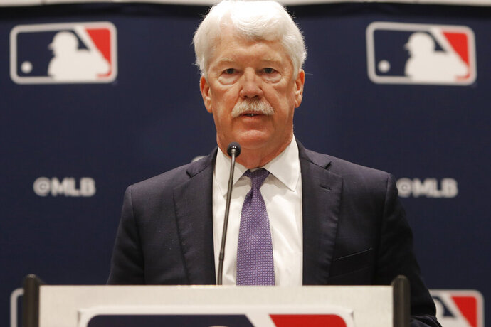 New Kansas City Royals owner John Sherman makes a brief statement to reporters after a baseball owners meeting in Arlington, Texas, Thursday, Nov. 21, 2019. (AP Photo/LM Otero)