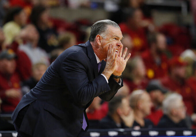TCU head coach Jamie Dixon directs his team against Iowa State in the first half of an NCAA college basketball game, Tuesday, Feb. 25, 2020, in Ames, Iowa. Iowa State won 65-59. (AP Photo/Matthew Putney)