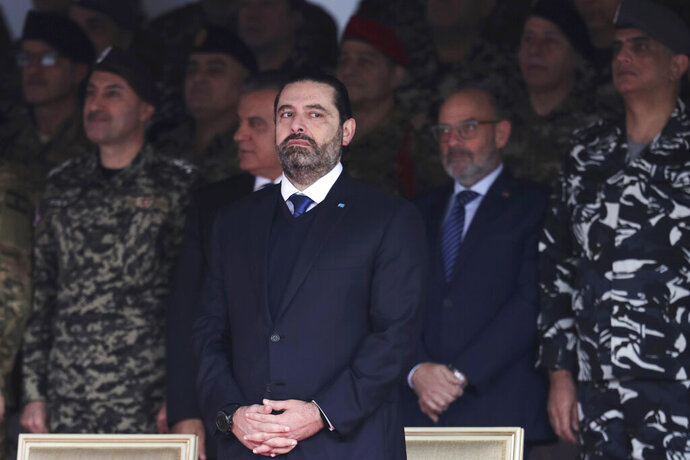 Former Prime Minister Saad Hariri attends a military parade to mark the 76th anniversary of Lebanon's independence from France at the Lebanese Defense Ministry, in Yarzeh near Beirut, Lebanon, Friday, Nov. 22, 2019. Lebanon's top politicians Friday attended a military parade on the country's 76th Independence Day, appearing for the first time since the government resigned amid nationwide protests now in their second month. (AP Photo/Hassan Ammar)