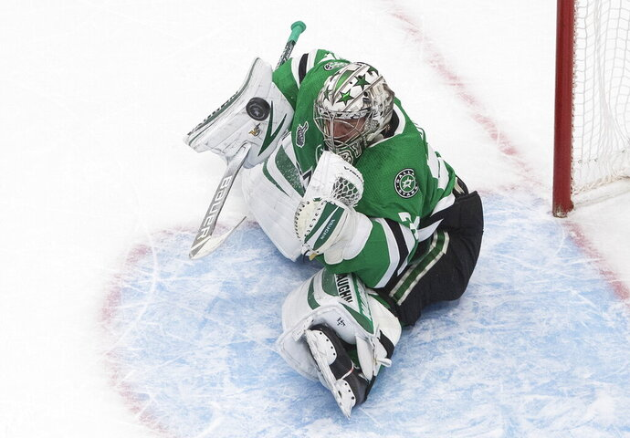 Dallas Stars goaltender Anton Khudobin makes a save against the Tampa Bay Lightning during the second period of Game 3 of the NHL hockey Stanley Cup Final, Wednesday, Sept. 23, 2020, in Edmonton, Alberta. (Jason Franson/The Canadian Press via AP)