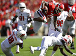 Georgia running back D'Andre Swift (7) leaps over Austin Peay defensive back Kordell Jackson (13) and Austin Peay linebacker Elijah Shepard (18) during the first half of an NCAA college football game, Saturday, Sept. 1, 2018, in Athens, Ga. (AP Photo/Mike Stewart)