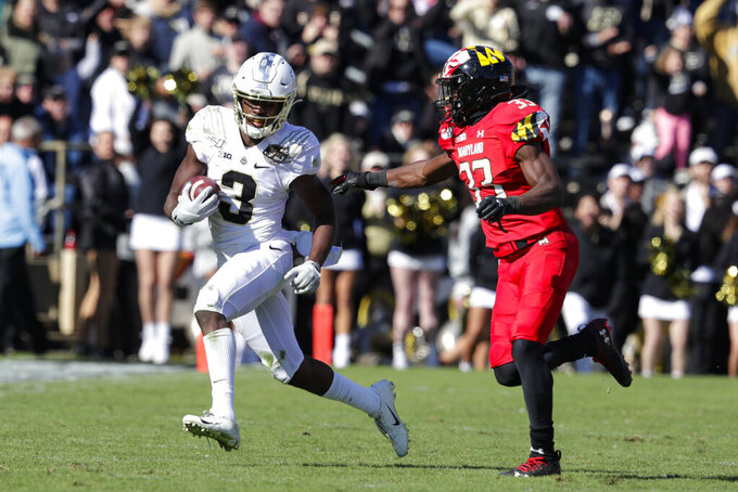 Purdue wide receiver David Bell (3) tries to get past Maryland defensive back Deonte Banks (33) as he picks up 30-yards on a catch during the second half of an NCAA college football game in West Lafayette, Ind., Saturday, Oct. 12, 2019. Purdue defeated Maryland 40-14. (AP Photo/Michael Conroy)
