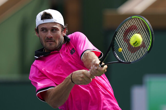 Tommy Paul returns a shot to Feliciano Lopez, of Spain, at the BNP Paribas Open tennis tournament Thursday, Oct. 7, 2021, in Indian Wells, Calif. (AP Photo/Mark J. Terrill)