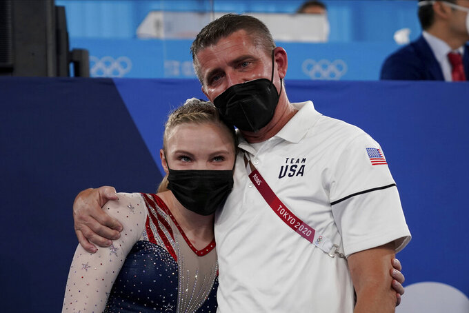 Jade Carey, of the United States, embraces her coach after winning the gold medal on the floor exercise during the artistic gymnastics women's apparatus final at the 2020 Summer Olympics, Monday, Aug. 2, 2021, in Tokyo, Japan. (AP Photo/Ashley Landis)