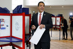 New York Gov. Andrew Cuomo speaks as he marks his primary election ballot at the Presbyterian Church of Mount Kisco, in Mount Kisco, N.Y., Thursday, Sept. 13, 2018. (AP Photo/Richard Drew)