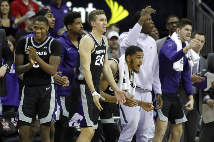 Kansas State players celebrate a basket during the second half of the team's NCAA college basketball game against TCU in the first round of the Big 12 men's tournament in Kansas City, Mo., Wednesday, March 11, 2020. Kansas State won 53-49. (AP Photo/Orlin Wagner)