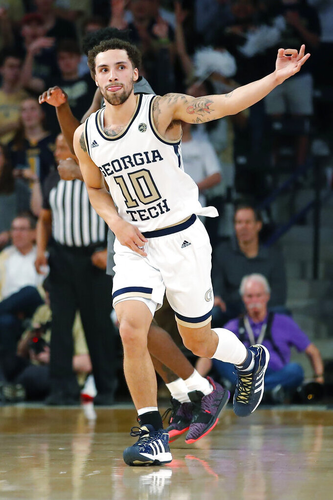 Georgia Tech guard Jose Alvarado (10) reacts after scoring a three pointer during the first half of an NCAA college basketball game against Louisville in Atlanta, Wednesday, Feb. 12, 2020. (AP Photo/Todd Kirkland)