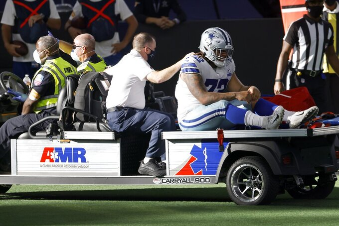 Dallas Cowboys defensive tackle Trysten Hill (72) is carted off the field by medical personnel after suffering an unknown injury in the second half of an NFL football game against the New York Giants in Arlington, Texas, Sunday, Oct. 11, 2020. (AP Photo/Ron Jenkins)