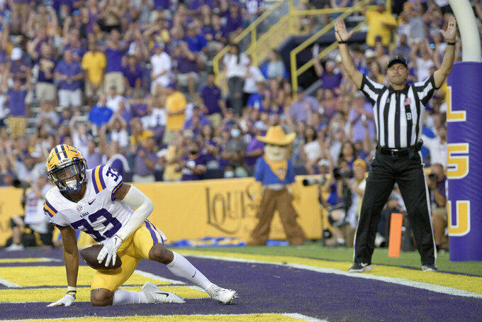 LSU wide receiver Trey Palmer gets up after his touchdown against McNeese State Andre Sam during the first half of an NCAA college football game in Baton Rouge, La., Saturday, Sept. 11, 2021. (AP Photo/Matthew Hinton)