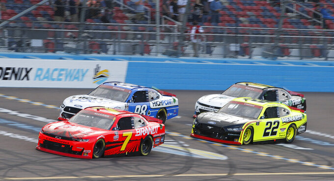 Justin Allgaier (7) leads Chase Briscoe (98), Austin Cindric (22) and Justin Haley (11) through Turn 4 during a NASCAR Xfinity Series auto race at Phoenix Raceway, Saturday, Nov. 7, 2020, in Avondale, Ariz. (AP Photo/Ralph Freso)