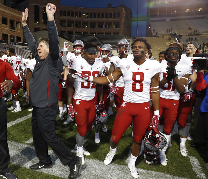 Washington State head coach Mike Leach, front, acknowledges the crowd as his team assembles to sing the school song after an NCAA college football game against Colorado Saturday, Nov. 10, 2018, in Boulder, Colo. Washington State won 31-7. (AP Photo/David Zalubowski)