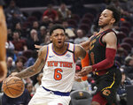 New York Knicks' Elfrid Payton (6) drives past Cleveland Cavaliers' Darius Garland (10) in the second half of an NBA basketball game, Monday, Jan. 20, 2020, in Cleveland. New York won 106-86. (AP Photo/Tony Dejak)