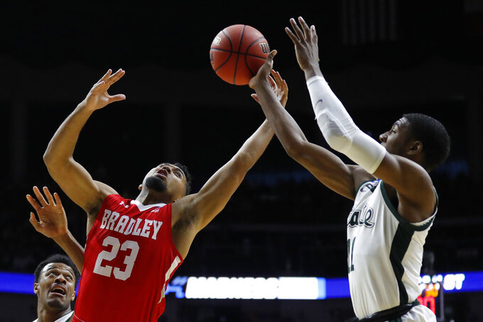 Bradley guard Dwayne Lautier-Ogunleye fights for a rebound with Michigan State forward Aaron Henry, right, during a first round men's college basketball game in the NCAA Tournament, Thursday, March 21, 2019, in Des Moines, Iowa. (AP Photo/Charlie Neibergall)