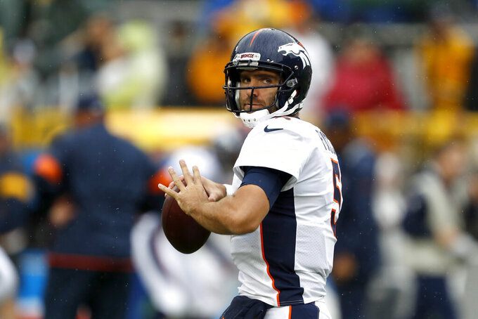 Denver Broncos quarterback Joe Flacco warms up before the start of an NFL football game against the Green Bay Packers, Sunday, Sept. 22, 2019, in Green Bay, Wis. (AP Photo/Matt Ludtke)