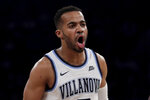 Villanova guard Phil Booth reacts after a basket against Seton Hall during the first half of an NCAA college basketball game in the championship of the Big East Conference tournament, Saturday, March 16, 2019, in New York. (AP Photo/Julio Cortez)