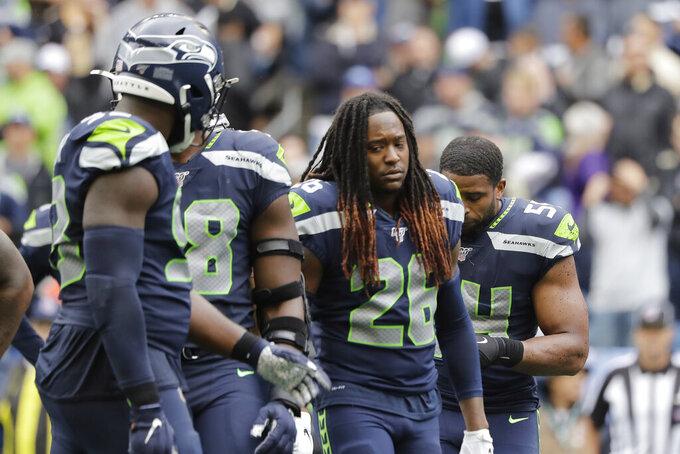 Seattle Seahawks' Shaquill Griffin (26) and teammates walk off the field late in the second half of an NFL football game against the New Orleans Saints, Sunday, Sept. 22, 2019, in Seattle. (AP Photo/Ted S. Warren)