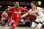 Ohio State guard Luther Muhammad (1) drives against Rutgers guard Caleb McConnell (22) during the second half of an NCAA college basketball game, Wednesday, Jan. 9, 2019, in Piscataway, N.J. Rutgers won 64-61. (AP Photo/Julio Cortez)