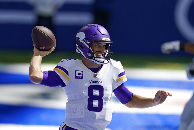 Minnesota Vikings quarterback Kirk Cousins (8) throws during the first half of an NFL football game against the Indianapolis Colts, Sunday, Sept. 20, 2020, in Indianapolis. (AP Photo/Michael Conroy)