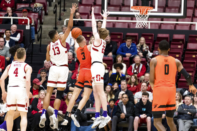 Oregon State forward Tres Tinkle (3) shoots as Stanford forward Oscar da Silva (13) and James Keefe (22) defend during the first half of an NCAA college basketball game Thursday, Jan. 30, 2020, in Stanford, Calif. (AP Photo/John Hefti)