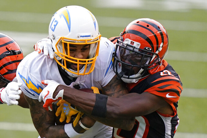 Los Angeles Chargers' Keenan Allen (13) is tackled by Cincinnati Bengals' William Jackson (22) during the second half of an NFL football game, Sunday, Sept. 13, 2020, in Cincinnati. (AP Photo/Bryan Woolston)