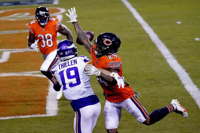 Minnesota Vikings wide receiver Adam Thielen (19) catches a touchdown pass as Chicago Bears cornerback Buster Skrine (24) and safety Tashaun Gipson Sr. (38) defend during the first half of an NFL football game Monday, Nov. 16, 2020, in Chicago. (AP Photo/Charles Rex Arbogast)