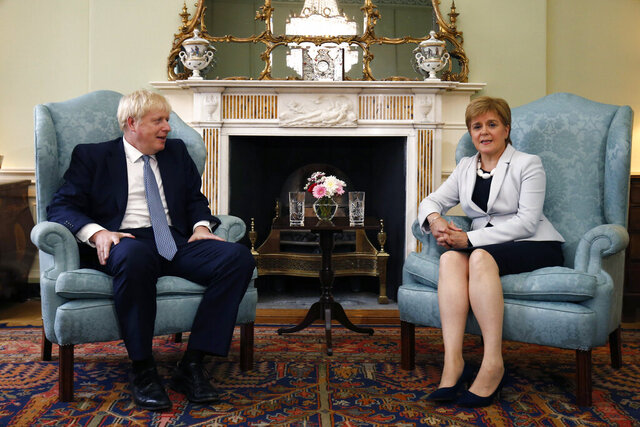 "FILE - In this Monday. July 29, 2019 file photo, Scotland's First Minister Nicola Sturgeon, right, sits with Britain's Prime Minister Boris Johnson, in Bute House, ahead of their meeting, in Edinburgh, Scotland.   Johnson has inflamed Scottish discontent with his Conservative government by reportedly saying that giving governing powers to Scotland had been a ""disaster."" British media reported that Johnson made the remarks during a video meeting with Conservative Party lawmakers on Monday, Nov. 16, 2020, in which he also said Scottish devolution had been former Prime Minister Tony Blair's ""biggest mistake."" (Duncan McGlynn/Poo Photo via AP, File )"