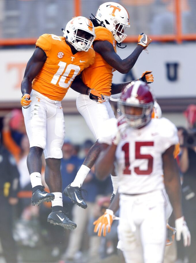Tennessee wide receiver Tyler Byrd (10) celebrates a touchdown with a teammate during the first half of an NCAA college football game against Alabama, Saturday, Oct. 20, 2018, in Knoxville, Tenn. (AP Photo/Wade Payne)