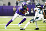 Minnesota Vikings wide receiver Stefon Diggs, left, runs from Philadelphia Eagles cornerback Sidney Jones, right, after catching a pass during the first half of an NFL football game, Sunday, Oct. 13, 2019, in Minneapolis. (AP Photo/Bruce Kluckhohn)