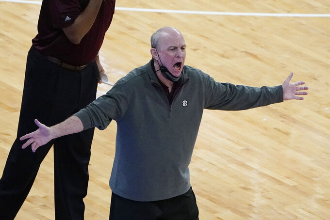 Mississippi State head coach Ben Howland complains about a call to officials during the second half of an NCAA college basketball game against Kentucky in Starkville, Miss., Saturday, Jan. 2, 2021. (AP Photo/Rogelio V. Solis)