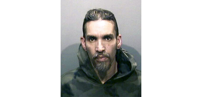 FILE - In this June 5, 2017, file photo, released by the Alameda County Sheriff's Office shows Derick Almena at Santa Rita Jail in Alameda County, Calif. Family members of the 36 people killed when a fire broke out at a San Francisco warehouse during a music event urged a judge Monday, March 8, 2021, to impose the toughest sentence for Derick Almena, the master tenant of the building, or reject a plea deal he struck with prosecutors to avoid a second trial. (Alameda County Sheriff's Office via AP, File)