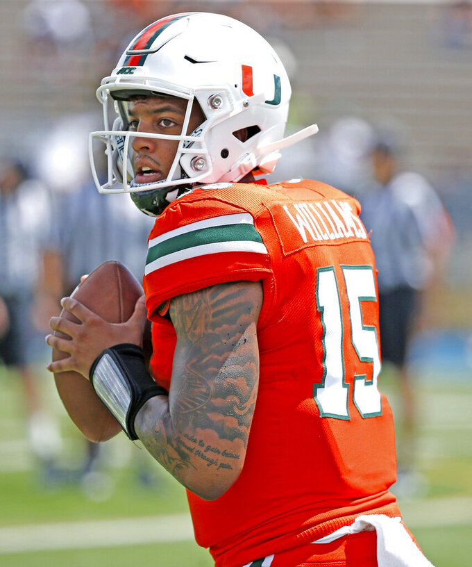 FILE - In this April 13, 2019, file photo, Miami quarterback Jarren Williams (15) sets up to pass during an NCAA college football scrimmage in Miami. Florida and Miami have the college football stage to themselves for 3 ½ hours Saturday, a new chapter in their once-heated and forever-storied rivalry. (Al Diaz/Miami Herald via AP, File)