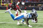 Atlanta Falcons free safety Ricardo Allen (37) hits Carolina Panthers tight end Ian Thomas (80) as Thomas scores a touchdown during the first half of an NFL football game, Sunday, Dec. 8, 2019, in Atlanta. (AP Photo/John Amis)