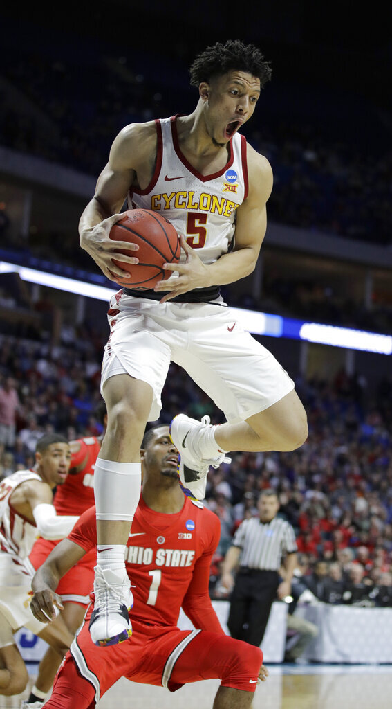 Iowa State's Lindell Wigginton beats Ohio State's Luther Muhammad (1) to a rebound during the first half of a first round men's college basketball game against Ohio State in the NCAA Tournament Friday, March 22, 2019, in Tulsa, Okla. (AP Photo/Charlie Riedel)