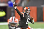 Cleveland Browns quarterback Baker Mayfield (6) throws during the first half of an NFL football game against the Baltimore Ravens, Monday, Dec. 14, 2020, in Cleveland. (AP Photo/David Richard)