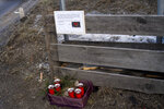 """Candle and a commemoration letter placed at the at the scene where a car has plowed into a group of people in Luttach, near Bruneck in the northern region South Tirol, Italy, Sunday, Germany, Jan. 5, 2020. Italian fire officials say a car has plowed into a group of young German tourists in northern Italy, killing ate least six people and injuring 11. The commemoration letter reads: """"We are stunned and shocked that our dear young German friends have been torn from life. The suffering of the many injured and all relatives makes us deeply concerned. You should know that many people are connected in grief to you. With silent greetings"""