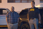 """This image released by STX Films shows Paul Walter Hauser, left, and Vince Vaughn in a scene from """"Queenpins."""" (STX Films via AP)"""