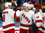 Carolina Hurricanes defenseman Dougie Hamiltobn (19) and Joel Edmundson (6) celebrate the winning goal during the overtime period of an NHL hockey game against the Buffalo Sabres, Thursday, Nov. 14, 2019, in Buffalo N.Y. (AP Photo/Jeffrey T. Barnes)