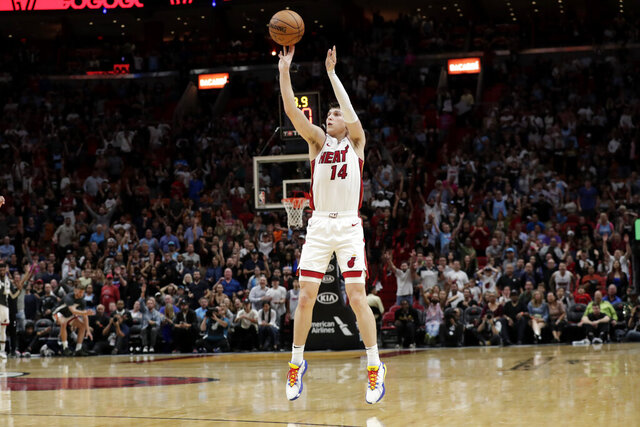 Miami Heat guard Tyler Herro (14) shoots a 3-pointer during overtime in an NBA basketball game against the Chicago Bulls, Sunday, Dec. 8, 2019, in Miami. The Heat won 110-105 in overtime. (AP Photo/Lynne Sladky)