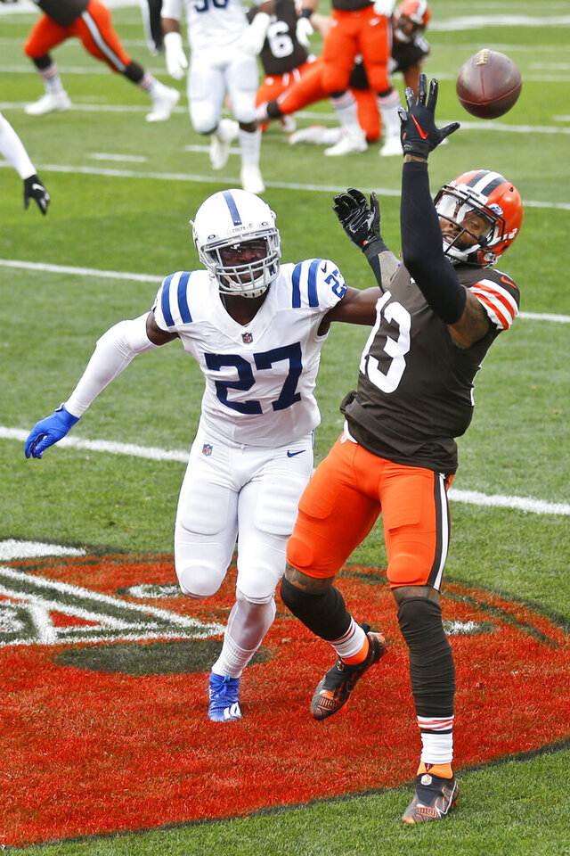 Cleveland Browns wide receiver Odell Beckham Jr. (13) cannot hold onto the ball in the end zone as Indianapolis Colts cornerback Xavier Rhodes (27) defends during the first half of an NFL football game, Sunday, Oct. 11, 2020, in Cleveland. (AP Photo/Ron Schwane)