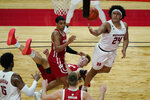 Rutgers' Ron Harper Jr., right, throws up a shot during the second half of the team's NCAA college basketball game against Wisconsin, Friday, Jan. 15, 2021, in Piscataway, N.J. Wisconsin defeated Rutgers 60-54.(AP Photo/Seth Wenig)