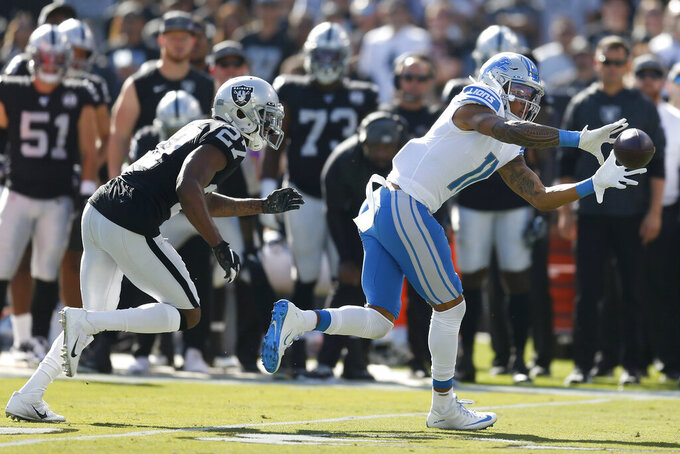 Detroit Lions wide receiver Marvin Jones Jr. (11) catches a pass in front of Oakland Raiders cornerback Trayvon Mullen (27) during the first half of an NFL football game in Oakland, Calif., Sunday, Nov. 3, 2019. (AP Photo/D. Ross Cameron)