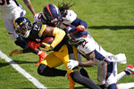 Pittsburgh Steelers wide receiver JuJu Smith-Schuster (19) is tackled by Denver Broncos strong safety Kareem Jackson (22) and linebacker A.J. Johnson during the first half of an NFL football game, Sunday, Sept. 20, 2020, in Pittsburgh. (AP Photo/Keith Srakocic)